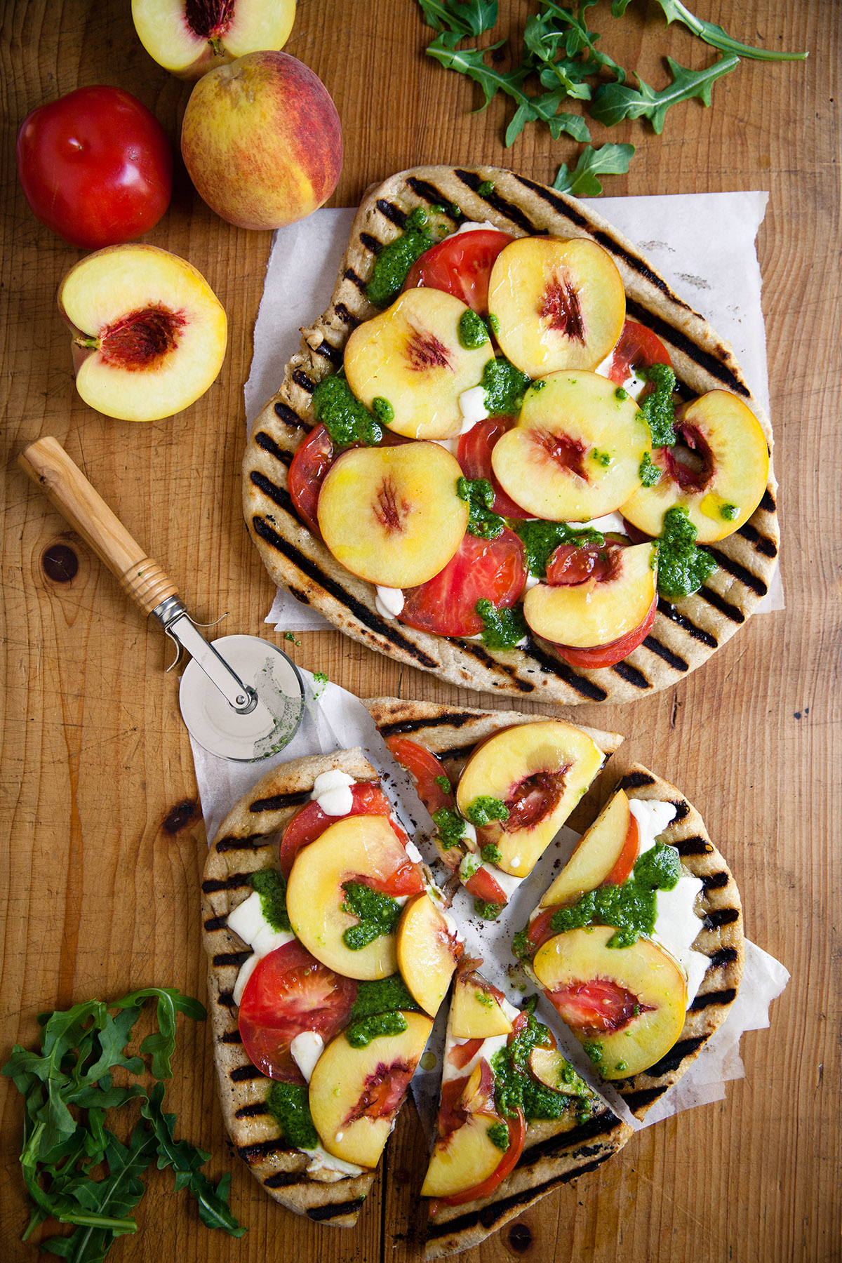 Grilled Peach and Tomato Pizza with Arugula Pesto