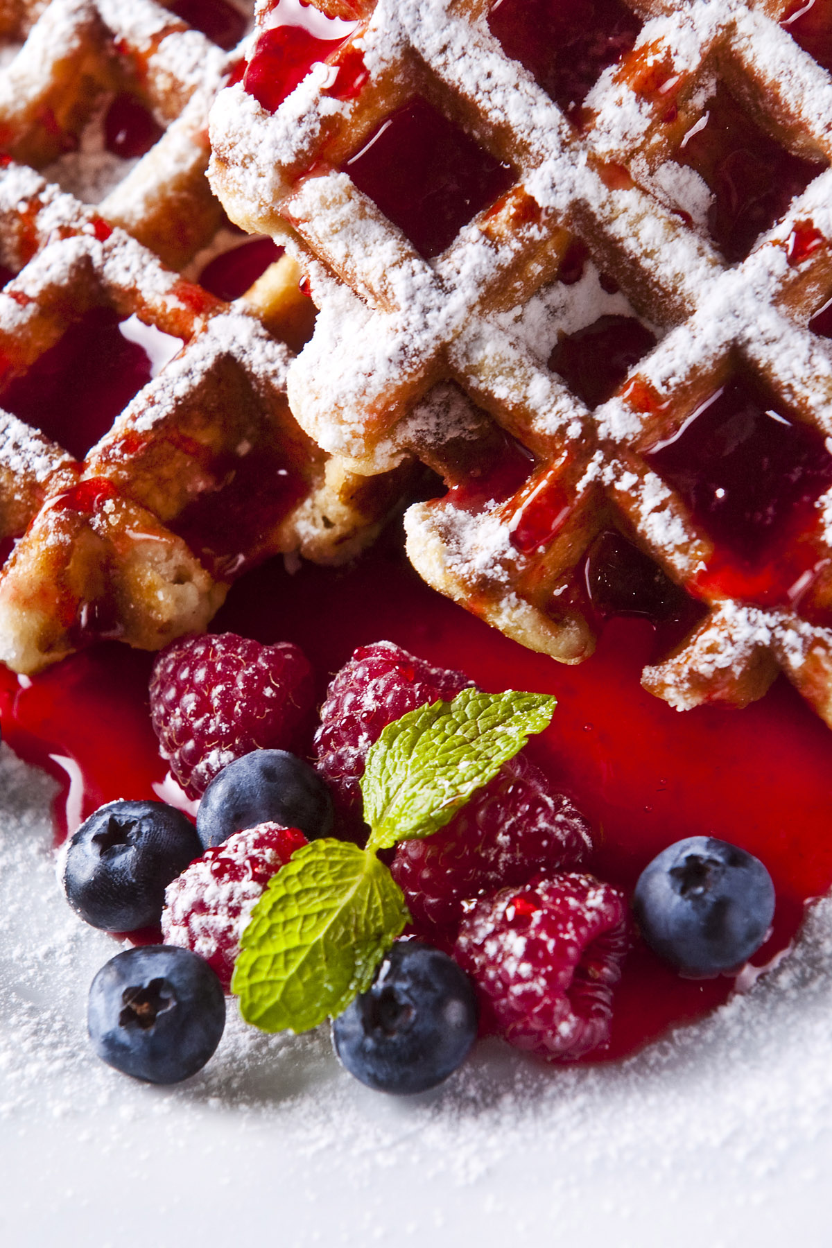 Lemon Poppyseed Waffles with Blueberry Citrus Syrup