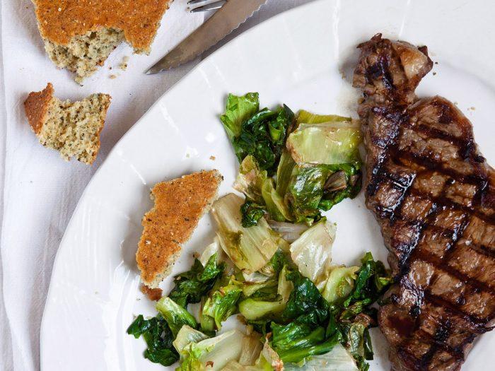 Strip Steak with Wilted Escarole and Cornbread