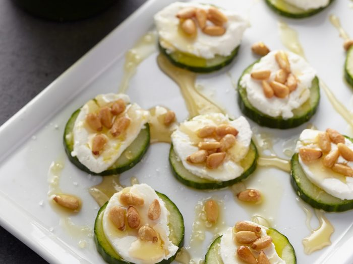 Cucumbers with Goat Cheese, Pine Nuts, and Honey