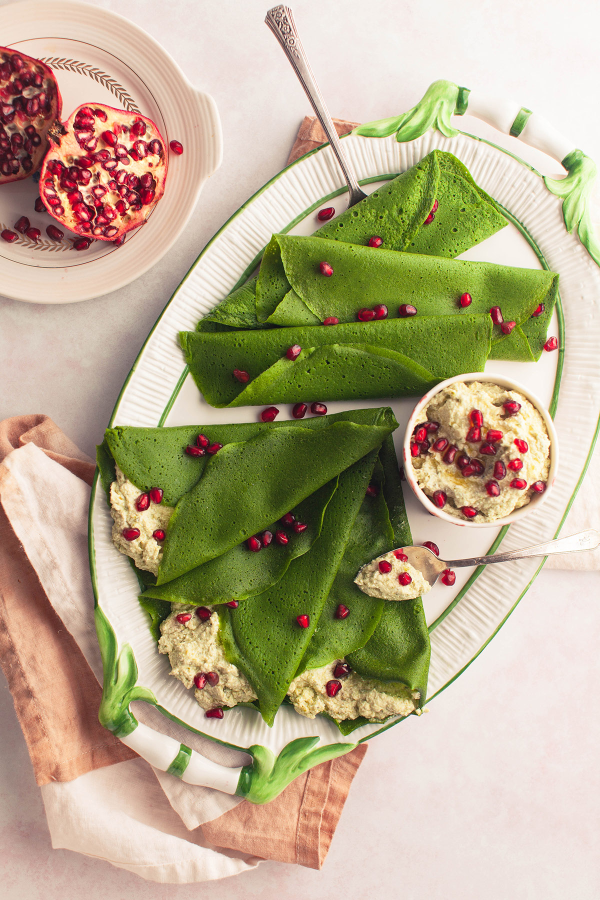 Pesto and Ricotta Filled Spinach Crepes with Pomegranate